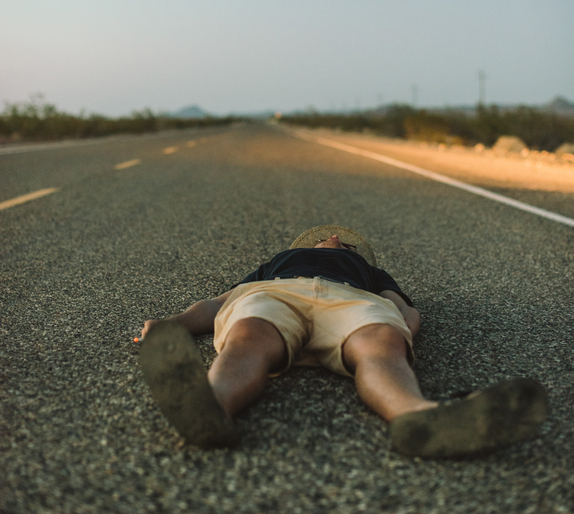 man-laying-in-road